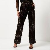 Pantaloni negri cu dungute aurii
